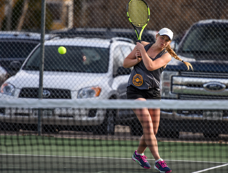Thompson Valley's Maddie Sheets hits a backhand against Loveland on Thursday March 8, 2018 at North Lake Park. (Cris Tiller / Loveland Reporter-Herald)