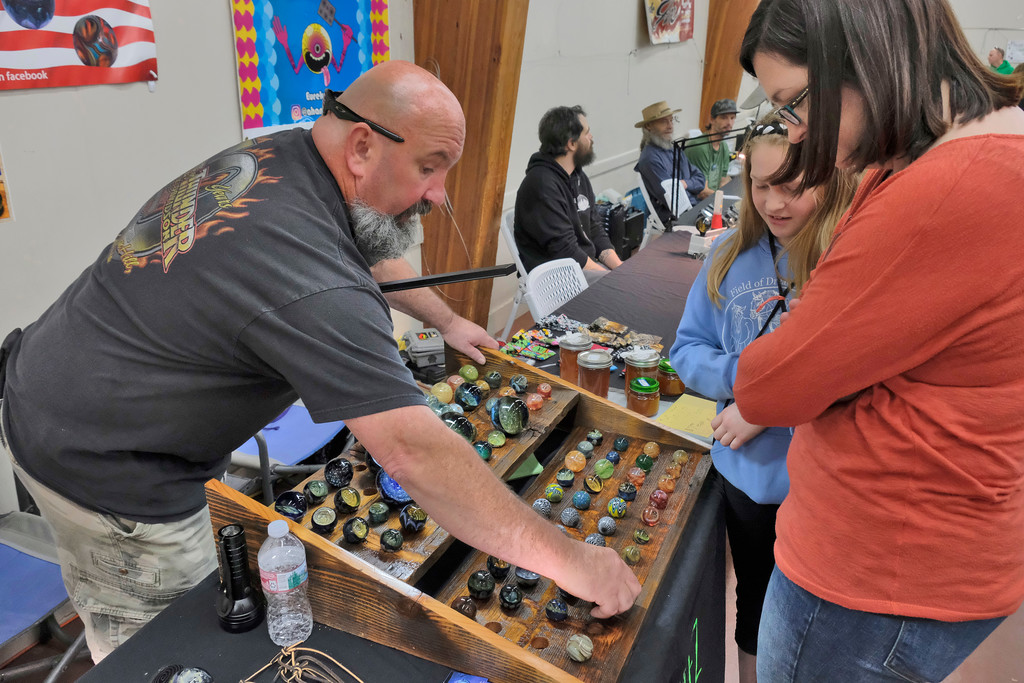 ". Shaun Walker � The Times-Standard  Joe Naish of Mojo Marblez shows his ornate marbles to Vicky Childs and daughter Keely, 11, of McKinleyville at the inaugural Humboldt Marble Weekend at Redwood Acres in Eureka on Saturday. The event continues today with the ""Massive Marble Hunt\"" starting at noon with marbles hidden in locations all over the county. Anyone can join one of several marble hunting groups on Facebook, watch for clues, and then try to find fancy marbles. For more info, go to humboldtmarbleweekend.com/massive-marble-hunt."