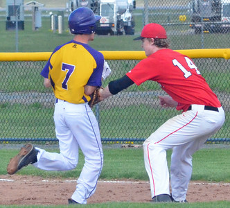 KYLE MENNIG - ONEIDA DAILY DISPATCH Vernon-Verona-Sherrill's Davey Moffett (14) tags out Holland Patent's Hunter Raehm (7) during the top of the second inning of their game in Rome on Tuesday, May 3, 2016.