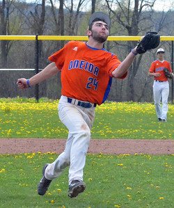 KYLE MENNIG - ONEIDA DAILY DISPATCH Oneida's James Dick runs in to make a catch and retire a Cazenovia batter during their game in Cazenovia on Saturday, May 7, 2016.
