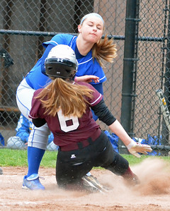 KYLE MENNIG - ONEIDA DAILY DISPATCH Stockbridge Valley's Madeline Cross (6) slides into home plate where she is tagged out by Madison's Lexi Tubbs (13) during their game in Munnsville on Thursday, May 5, 2016.