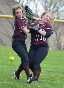 KYLE MENNIG - ONEIDA DAILY DISPATCH Stockbridge Valley's Kendra Webb (10) and Haylee Eaton (16) collide on a fly ball hit by a Brookfield batter during their game in Munnsville on Wednesday, May 4, 2016.