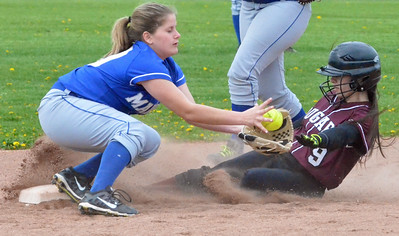 KYLE MENNIG - ONEIDA DAILY DISPATCH Stockbridge Valley's Catherine Meeker (9) slides under the tag of Madison's Baileigh Strong (10) for a stolen base during their game in Munnsville on Thursday, May 5, 2016.