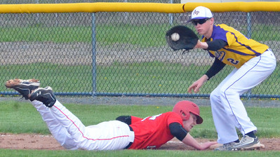 KYLE MENNIG - ONEIDA DAILY DISPATCH Vernon-Verona-Sherrill's Davey Moffett (14) dives safely back into first as Holland Patent's Conner Ludwin (2) fields a pickoff throw during the bottom of the first inning of their game in Rome on Tuesday, May 3, 2016.
