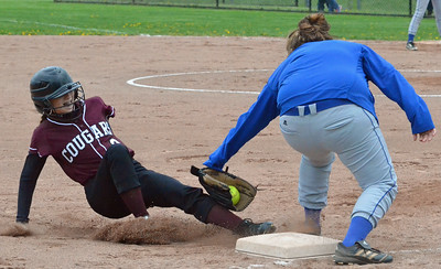 KYLE MENNIG - ONEIDA DAILY DISPATCH Madison's Sierra Abrams tags out Stockbridge Valley's Erin Raymond (3) as she slides into third during their game in Munnsville on Thursday, May 5, 2016.