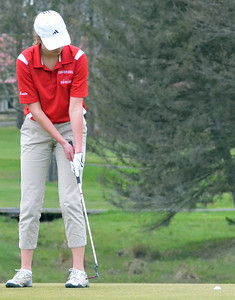 KYLE MENNIG - ONEIDA DAILY DISPATCH  Vernon-Verona-Sherrill's Cecelia Kaido watches her putt go in the hole on the ninth green during a match against Rome Free Academy in Rome on Tuesday, May 3, 2016.