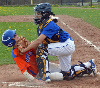 KYLE MENNIG - ONEIDA DAILY DISPATCH Oneida's Tanner Williams, left, slides into home plate where he is tagged out by Cazenovia catcher Evan Begley during the top of the fourth inning of their game in Cazenovia on Saturday, May 7, 2016.