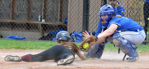KYLE MENNIG - ONEIDA DAILY DISPATCH Stockbridge Valley's Kendra Webb (10) slides safely into home under the tag of Madison's Kayla Usborne (1) during their game in Munnsville on Thursday, May 5, 2016.