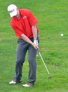 KYLE MENNIG - ONEIDA DAILY DISPATCH  Vernon-Verona-Sherrill's Henry Cleveland chips towards the green on hole No. 18 during a match against Rome Free Academy in Rome on Tuesday, May 3, 2016.