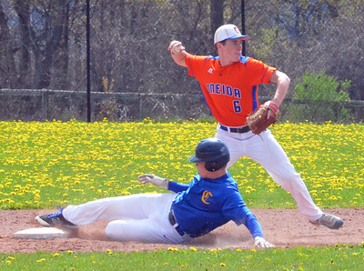 KYLE MENNIG - ONEIDA DAILY DISPATCH Cazenovia's Matt Regan (11) slides into second as Oneida's Henry Froass (6) throws to first to try and complete a double play during their game in Cazenovia on Saturday, May 7, 2016.