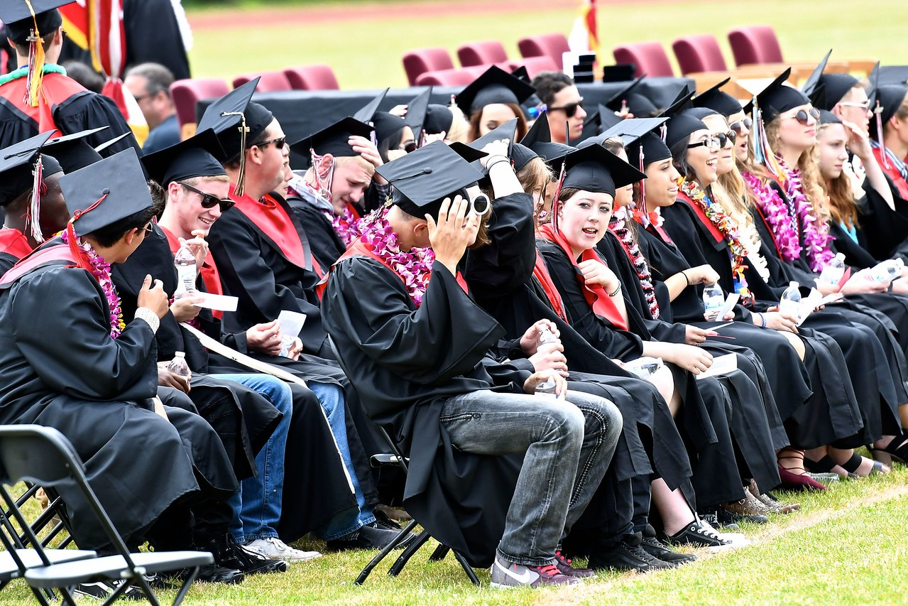 McKinleyville High Seniors have some final banter among themselves before receiving their diplomas. (José Quezada—For the Times-Standard)