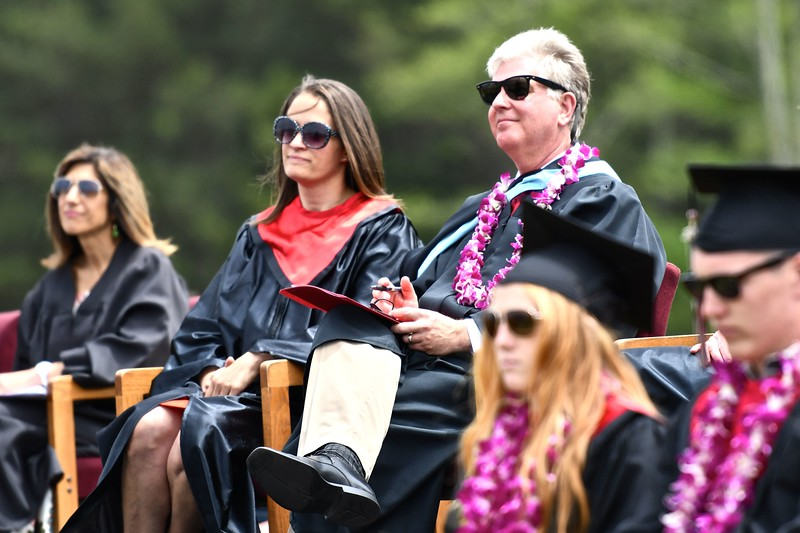 McKinleyville High School Principal Roger Macdonald listens to class musicians while wearing a purple lei in honor of his 9-year-old child battling cancer. (José Quezada—For the Times-Standard)