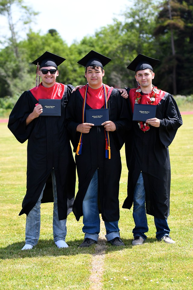 Three cousins graduating from McKinleyville High School take an impromptu pose together before running off to join their recently graduated classmates from McKinleyville High School. (José Quezada—For the Times-Standard)
