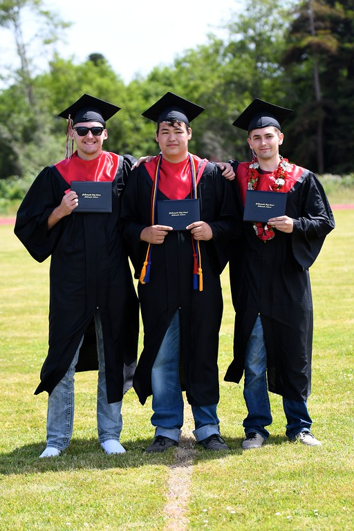 . Three cousins graduating from McKinleyville High School take an impromptu pose together before running off to join their recently graduated classmates from McKinleyville High School. (José Quezada�For the Times-Standard)