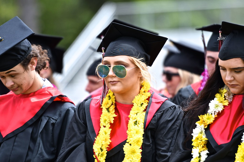 . Final reflections as a McKinleyville High School graduate-to-be faces hundreds of family and well-wishers jamming Panther Stadium. (José Quezada�For the Times-Standard)