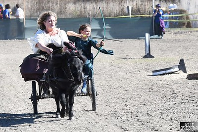 Sonia Hought manages Endermen, a miniature horse, as he pulls a bow-wielding   Annika Sorensen, both members of the Blue Lake Archery Group. José Quezada—For Times-Standard