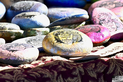 Decorated stones bearing the festival logo was at the ready for festival celebrants. José Quezada—For Times-Standard