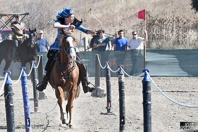 """The """"Queen""""of horse archery takes aim at a target as she gallops on her steed. José Quezada—For Times-Standard"""