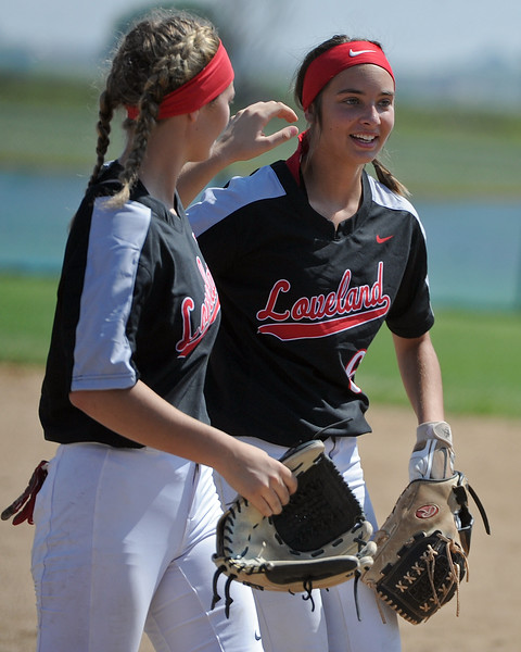 Loveland's Sage Baldwin, left, high-fives Kammrie Bakovich during a game Saturday, Sept. 8, 2018 at Mountain View High School in Loveland. (Sean Star/Loveland Reporter-Herald)