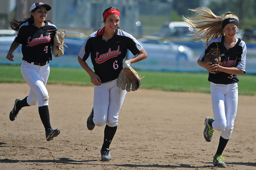 . Loveland\'s (from left) Emma Duran, Kammrie Bakovich and Avery Buhler trot off the field during a game Saturday, Sept. 8, 2018 at Mountain View High School in Loveland. (Sean Star/Loveland Reporter-Herald)