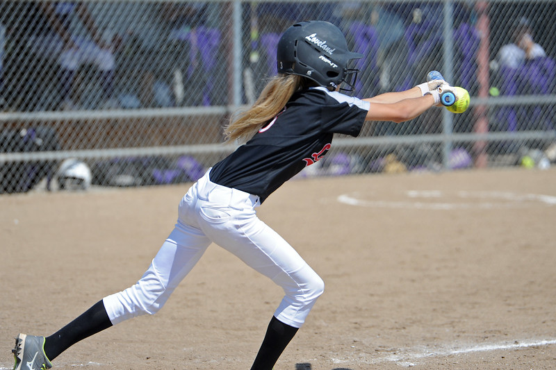 Loveland's Avery Buhler bunts during a game Saturday, Sept. 8, 2018 at Mountain View High School in Loveland. (Sean Star/Loveland Reporter-Herald)