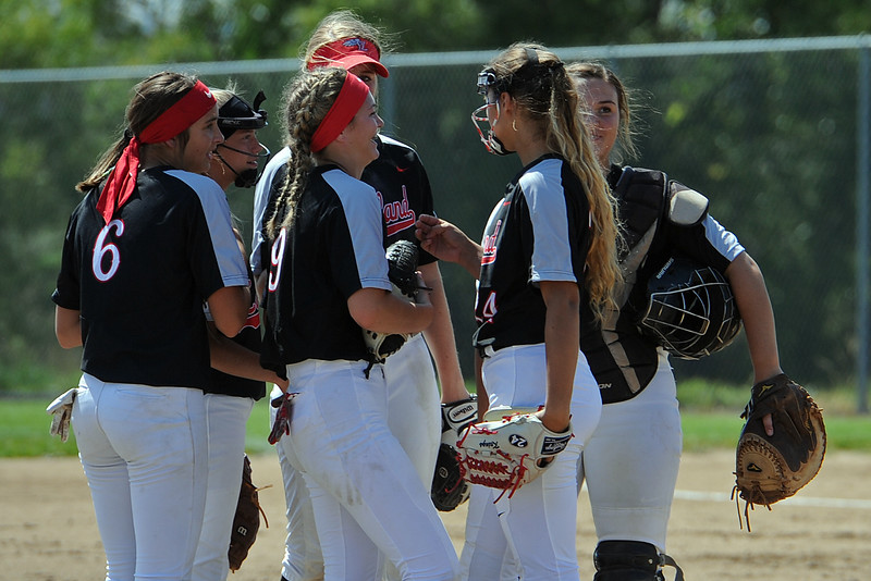 The Loveland softball team meets at the mound during a game Saturday, Sept. 8, 2018 at Mountain View High School in Loveland. (Sean Star/Loveland Reporter-Herald)