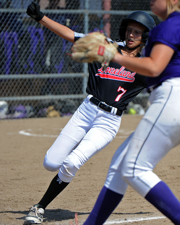 . Loveland\'s Chloe Stevens gets ready to slide into home next to Mountain View\'s Bailey Carlson during a game Saturday, Sept. 8, 2018 at Mountain View High School in Loveland. (Sean Star/Loveland Reporter-Herald)