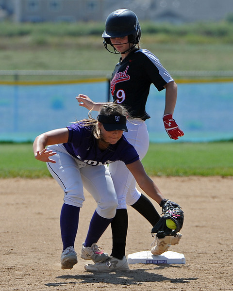 Mountain View's Morgan Jewell scoops a throw as Loveland's Sage Baldwin makes it safely to second base during a game Saturday, Sept. 8, 2018 at Mountain View High School in Loveland. (Sean Star/Loveland Reporter-Herald)