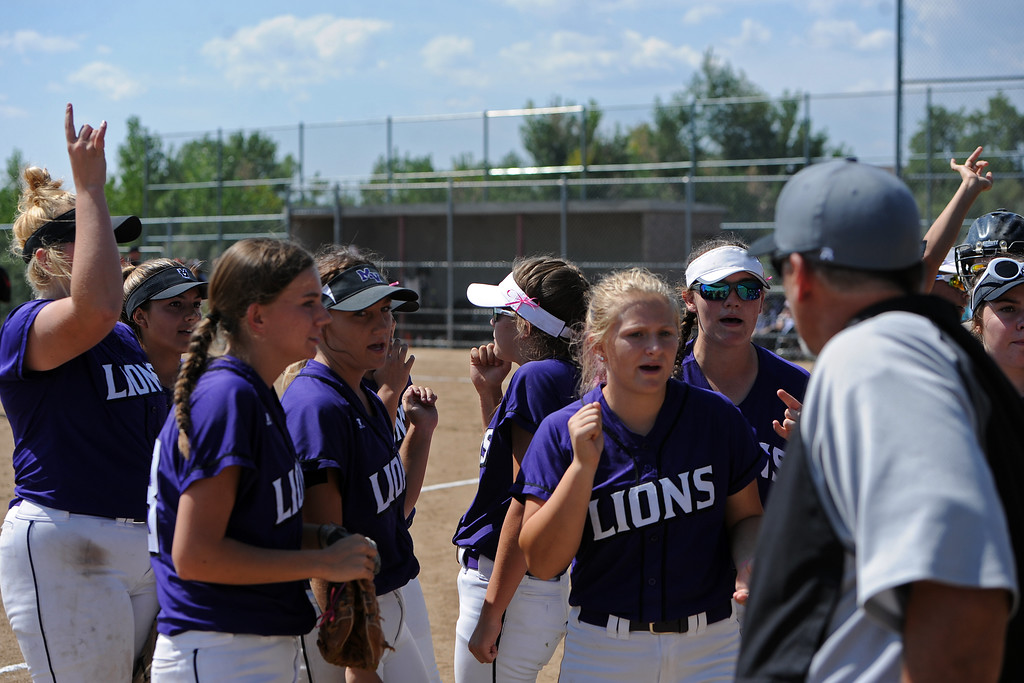 . Mountain View breaks a huddle between innings during a game Saturday, Sept. 8, 2018 at Mountain View High School in Loveland. (Sean Star/Loveland Reporter-Herald)