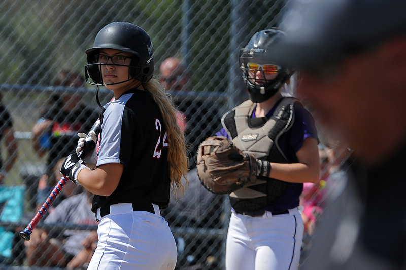 Loveland's Laurin Krings looks to the Mountain View dugout next to catcher Nicole Rogers after getting intentionally walked during a game Saturday, Sept. 8, 2018 at Mountain View High School in Loveland. (Sean Star/Loveland Reporter-Herald)