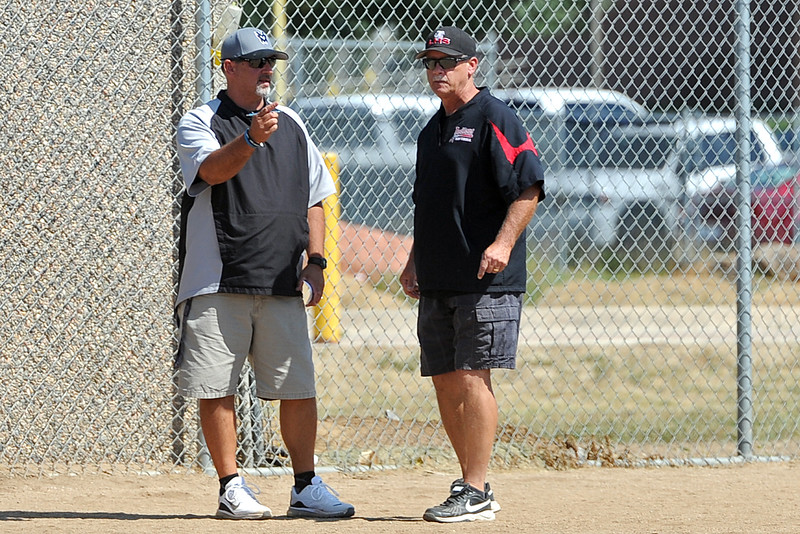 Mountain View coach Randy Felton, left, talks with his brother, Loveland coach Mike Felton, during a game Saturday, Sept. 8, 2018 at Mountain View High School in Loveland. (Sean Star/Loveland Reporter-Herald)