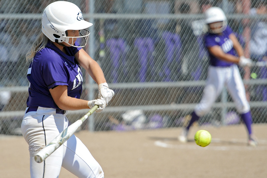 . Mountain View\'s Kamryn Leoffler takes a swing during a game Saturday, Sept. 8, 2018 at Mountain View High School in Loveland. (Sean Star/Loveland Reporter-Herald)