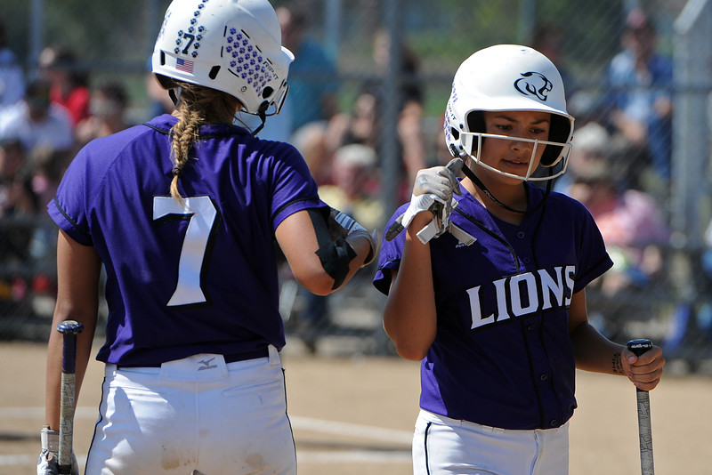 Mountain View's Jaelyn Taylor, right, gets a dap from Nya Chacon during a game Saturday, Sept. 8, 2018 at Mountain View High School in Loveland. (Sean Star/Loveland Reporter-Herald)
