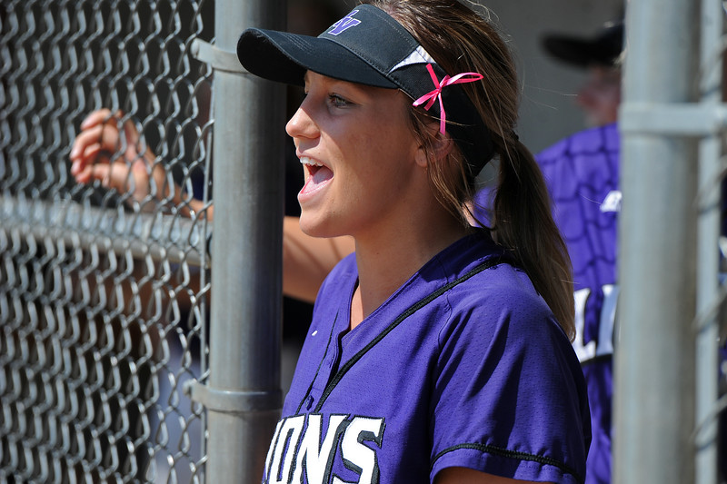 Mountain View's Kamryn Leoffler cheers from the dugout during a game Saturday, Sept. 8, 2018 at Mountain View High School in Loveland. (Sean Star/Loveland Reporter-Herald)