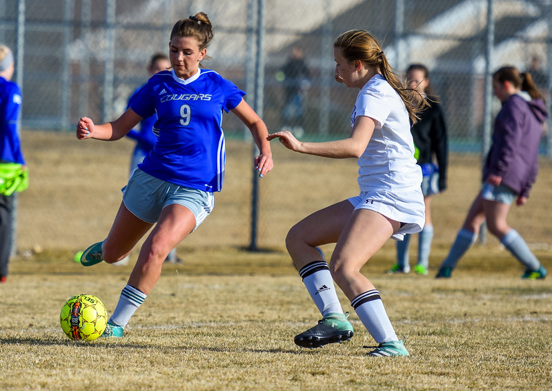 Resurrection Christian's Ashley McCall (9) dribbles past the defense of Mountain View on Tuesday March 20, 2018 at MVHS. (Cris Tiller / Loveland Reporter-Herald)