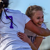 Mountain View sophomore Jacey Paoli is hugged by a teammate after scoring two goals in a 2-0 win over Resurrection Christian on Tuesday March 20, 2018 at MVHS. (Cris Tiller / Loveland Reporter-Herald)