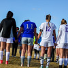 Resurrection Christian and Mountain View girls soccer players hold hands in prayer after the match on Tuesday March 20, 2018 at MVHS. (Cris Tiller / Loveland Reporter-Herald)