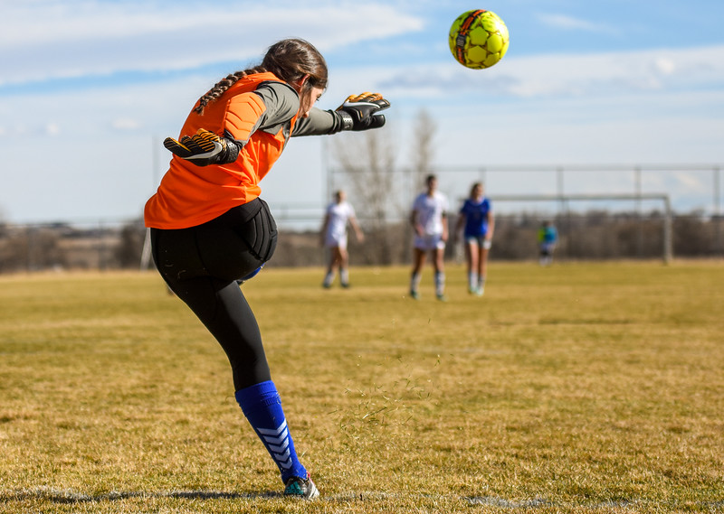 Resurrection Christian goalkeeper Faith Brown takes a goal kick against Mountain View on Tuesday March 20, 2018 at MVHS. (Cris Tiller / Loveland Reporter-Herald)