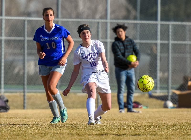 Mountain View's Kaylee McKie (16) tries for a through ball against Resurrection Christian on Tuesday March 20, 2018 at MVHS. (Cris Tiller / Loveland Reporter-Herald)