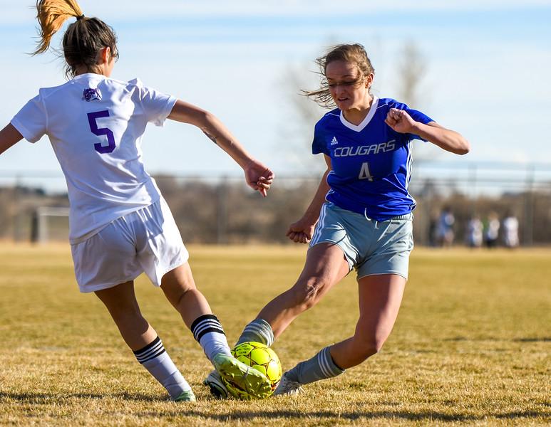 Resurrection Christian's Jenni Pronozuk (4) shoots the ball as Mountain View's Alyssa Perez (5) defends on Tuesday March 20, 2018 at MVHS. (Cris Tiller / Loveland Reporter-Herald)