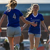 Resurrection Christian's Jadyn Anderson (16) gives a high five to Jenni Pronozuk after getting subbed out on Tuesday March 20, 2018 at MVHS. (Cris Tiller / Loveland Reporter-Herald)