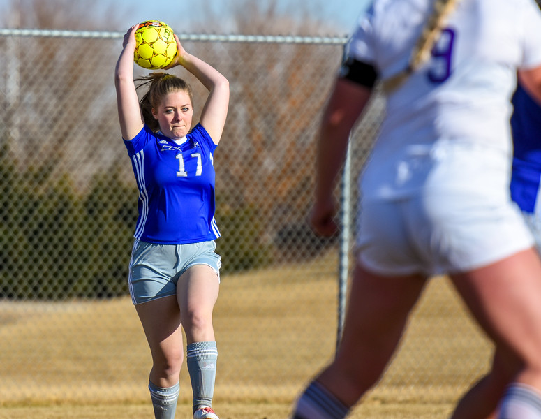 Resurrection Christian's Colby Wolf makes a throw in against Mountain View on Tuesday March 20, 2018 at MVHS. (Cris Tiller / Loveland Reporter-Herald)