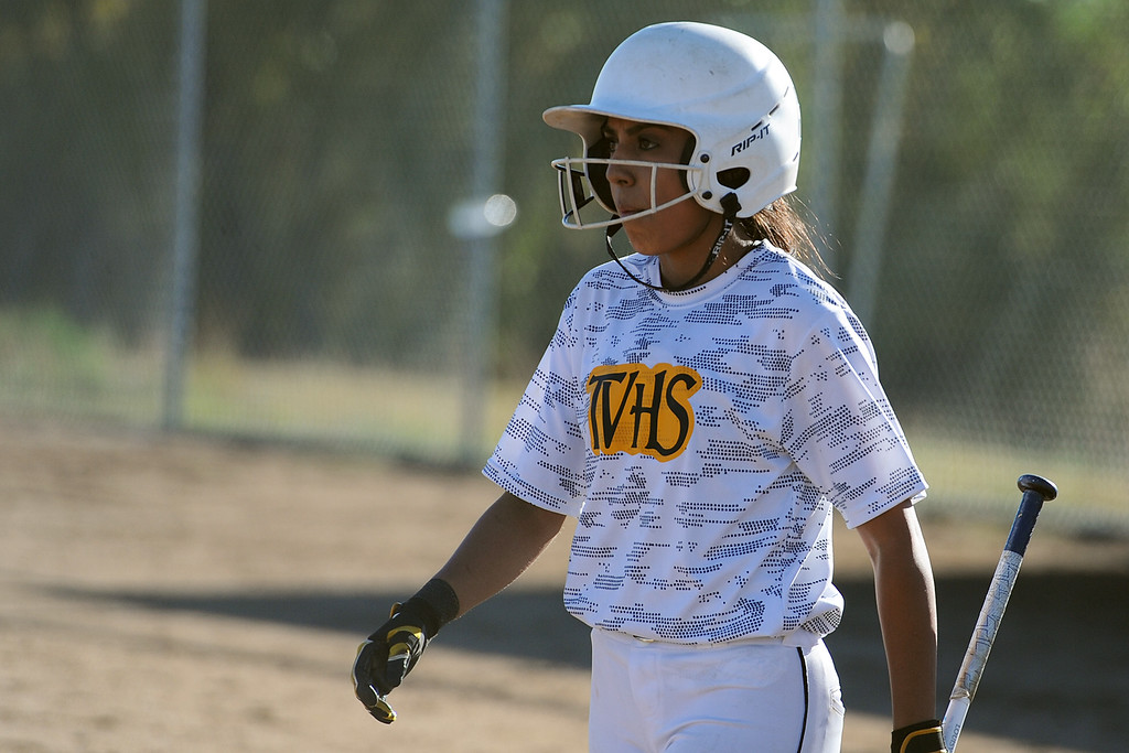 . Thompson Valley\'s Sierra Ortiz looks toward third base for signs from coach Bryon Rutherford during a game Thursday, Oct. 4, 2018 at Mountain View High School. (Sean Star/Loveland Reporter-Herald)