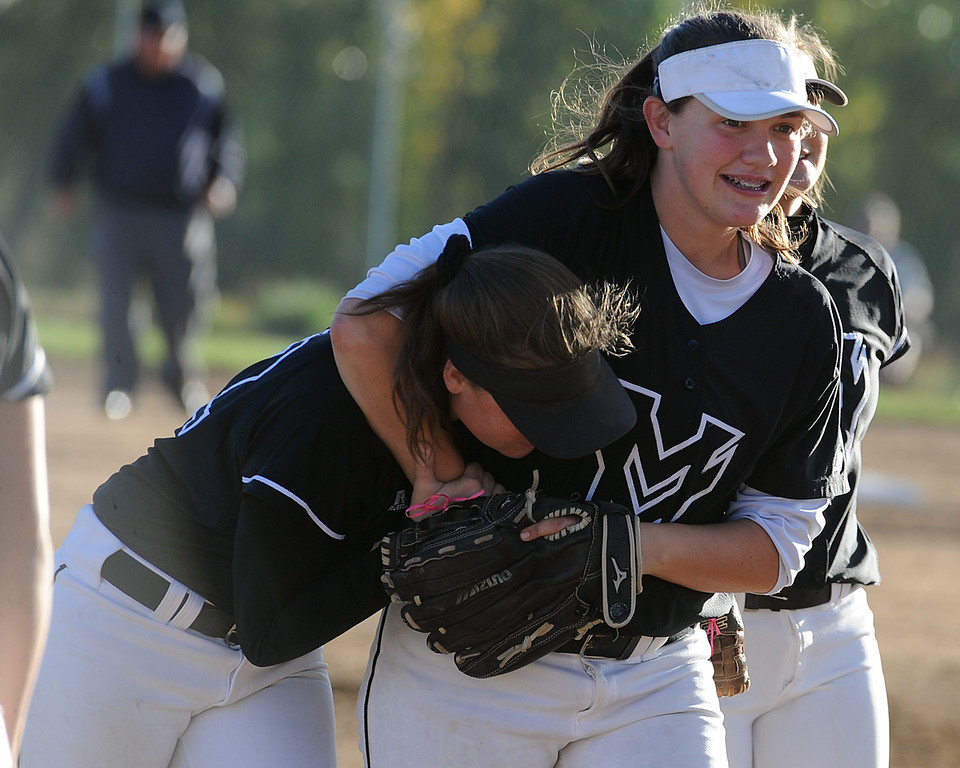 . Mountain View\'s RaLeigh Basart puts her younger sister Kelsey in a head lock after their game Thursday, Oct. 4, 2018 at Mountain View High School. (Sean Star/Loveland Reporter-Herald)