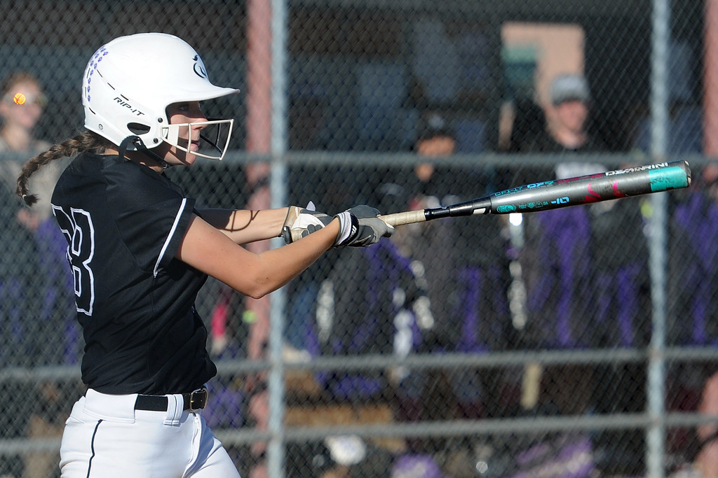 . Mountain View\'s Michelle Pomranka takes a swing during a game Thursday, Oct. 4, 2018 at Mountain View High School. (Sean Star/Loveland Reporter-Herald)