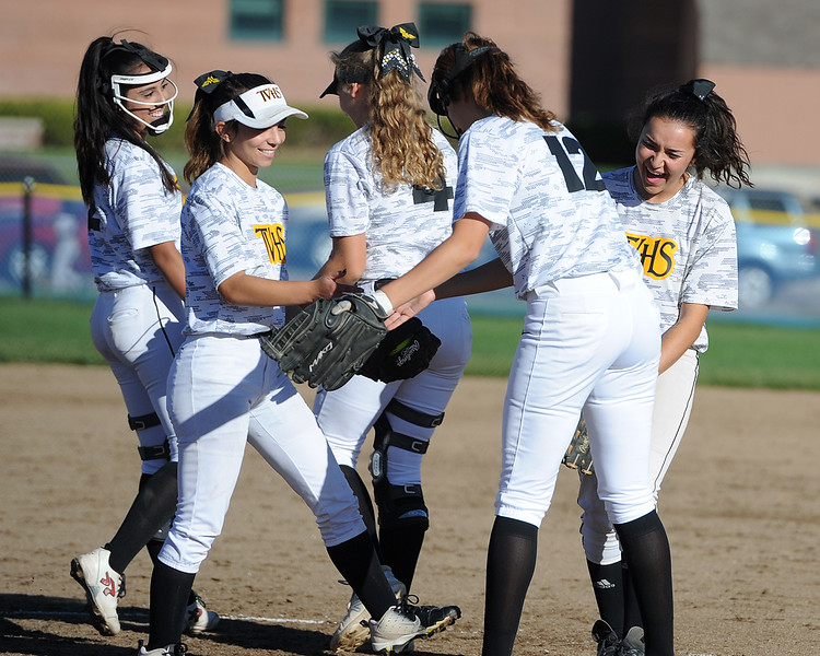 Thompson Valley teammates share a laugh between innings during their game Thursday, Oct. 4, 2018 at Mountain View High School. (Sean Star/Loveland Reporter-Herald)
