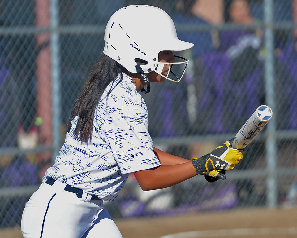 . Thompson Valley\'s Sierra Ortiz squares to bunt during a game Thursday, Oct. 4, 2018 at Mountain View High School. (Sean Star/Loveland Reporter-Herald)