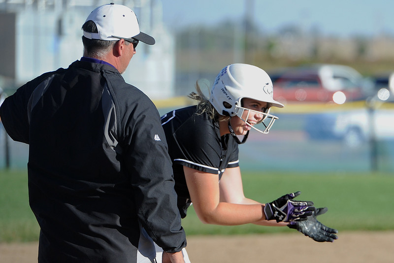 Mountain View's Bailey Carlson claps next to coach Randy Felton after hitting a triple during a game Thursday, Oct. 4, 2018 at Mountain View High School. (Sean Star/Loveland Reporter-Herald)