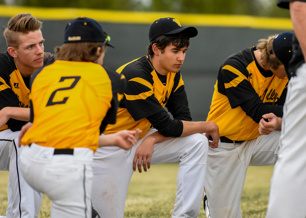 . Thompson Valley players kneel in disappointment after losing to crosstown rival Mountain View on Thursday April 5, 2018 at Brock Field. (Cris Tiller / Loveland Reporter-Herald)