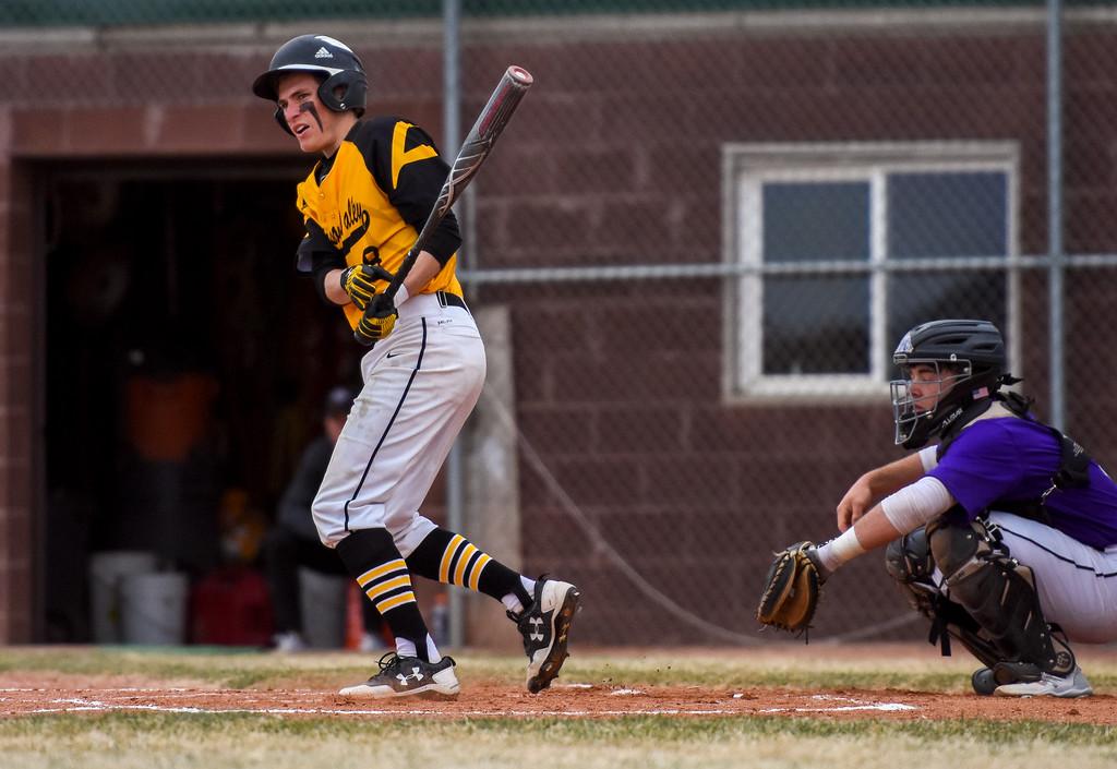 . Thompson Valley shortstop Austin Sobraske eyes a fould ball against rival Mountain View on Thursday April 5, 2018 at Brock Field. (Cris Tiller / Loveland Reporter-Herald)